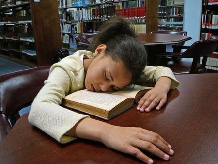 Child fell asleep while studying. photo