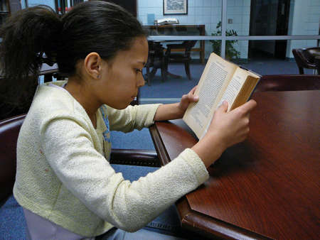 Child studying in the library photo