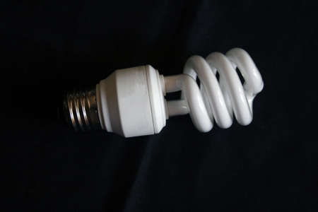 Compact fluorescent bulb on black