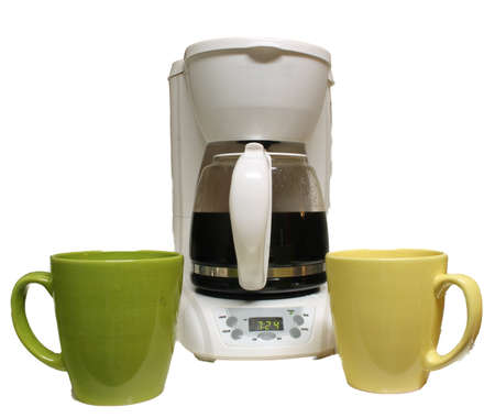 Coffee pot with mugs on white background