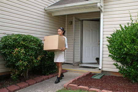 Girl moving out of a house
