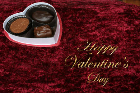 Valentine candy on red background with text