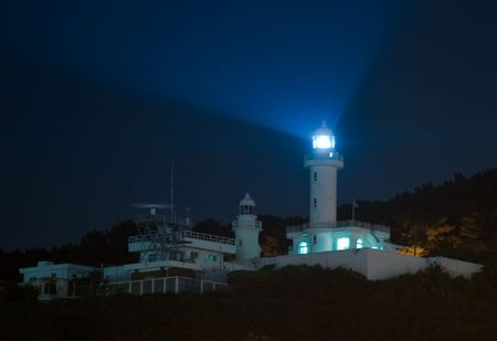 Light rays at night from a lighthouse