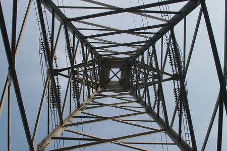 Bottom view of metal electrical pylon with wires