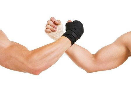 hand grip: Hand in a white glove and hand in a black glove clasped arm wrestling, isolated on white, good and evil opposition
