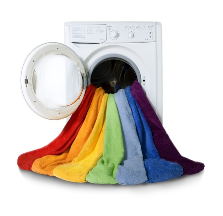 working machines: Washing machine and colorful things to wash, Isolated  Stock Photo