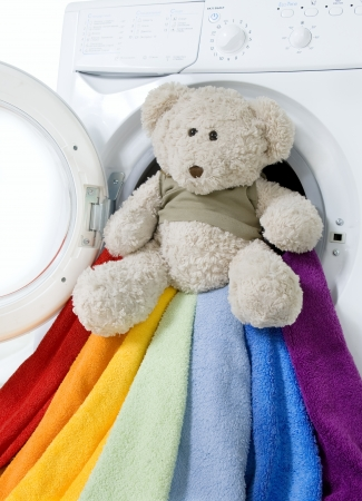Washing machine, toy and colorful things to wash  Stock Photo