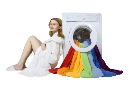 Beauty young girl and washing machine with colorful things to wash, Isolated  photo