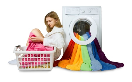 lave: young girl and washing machine with colorful things to wash, isolated