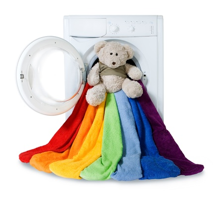 Washing machine, toy and colorful things to wash, isolated  Stockfoto