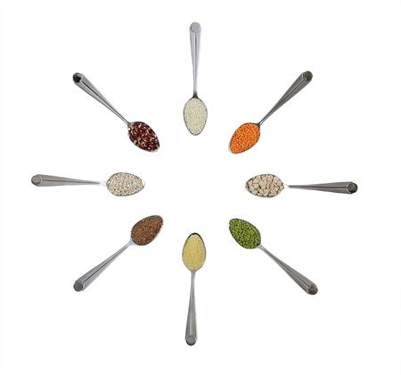 spoons with different colorful cereals isolated on white Banque d'images