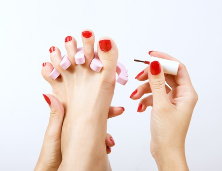 pedicure process - red manicure and pedicure  免版税图像