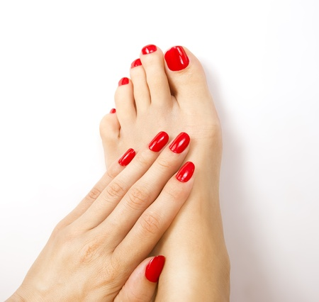Red manicure and pedicure photo
