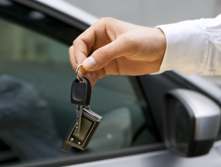 Man handing car keys  Stock Photo - 20941864