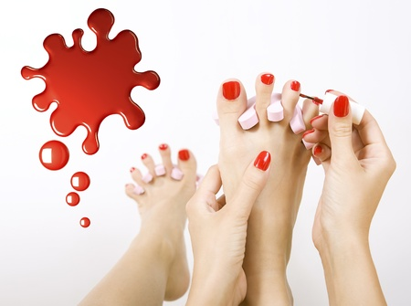 pedicure process - red manicure and pedicure  photo