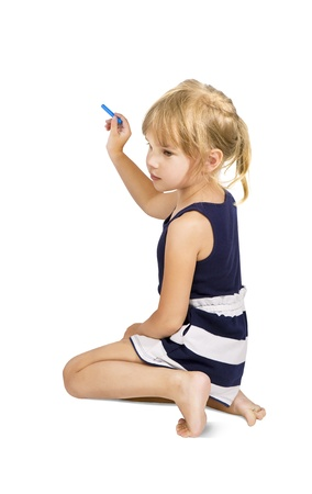 kid holding a chalk about to write, Little girl with a color chalk