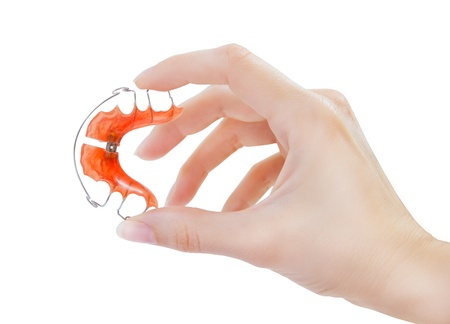 hand holding retainer for teeth photo