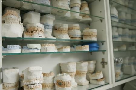medical cabinet: dental gypsum models, dentists office Stock Photo