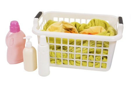 handwash: Wash colored laundry. Detergents and towels in white plastic basket, basket with colorful laundry to wash (handwash)