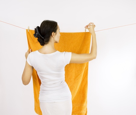 hanged clothes drying - girl with clothespin and the clothesline