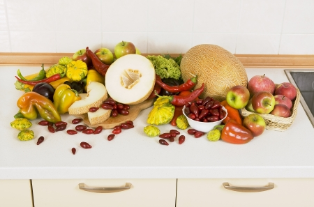 homelike: lots of vegetables and fruits on the kitchen table