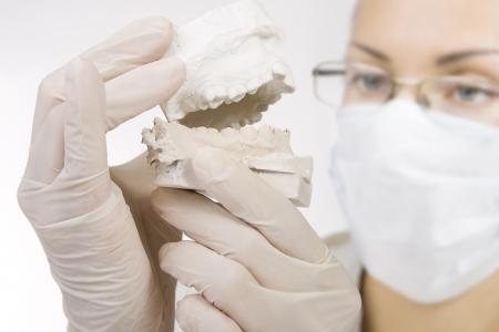 Woman holding a teeth sample