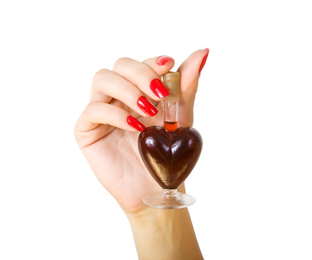 female hand holding elixir of Love photo