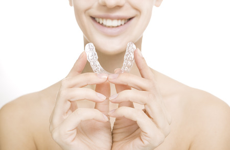 Beautiful smiling girl with tooth tray (hands holding individual tooth tray) 스톡 콘텐츠