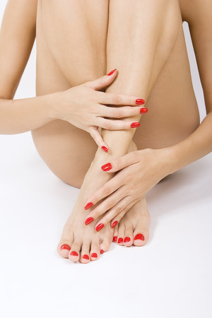 sexy female foot with red pedicure - - red manicure and pedicure  photo