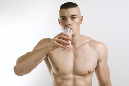 athletic young man with protein shake photo
