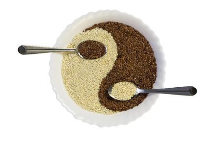 sesame seeds: Eastern cuisine - sesame seeds in yin yang shape plate, isolated