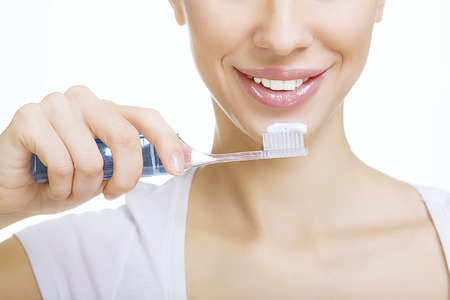 Closeup girl with toothbrush cleaning teeth at home, dental care and whiten toothpaste