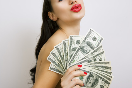 Oldest profession - Female sexy red lips and dollar banknotes (Whoredom) photo