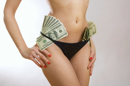 Oldest profession - Female perfect sexy body and banknotes (Beautiful womens buttocks in sexy black panties with dollars) photo