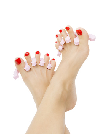 female foot with red pedicure close up, isolated on white background photo