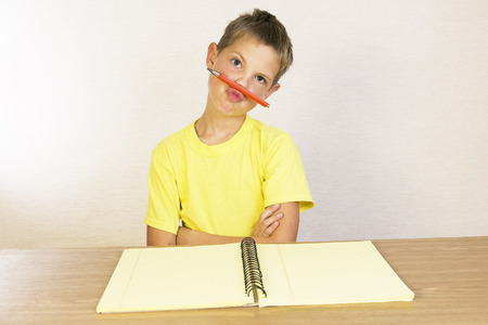 A kid showing his attitude, school boy does not want to learn the lessons Stockfoto