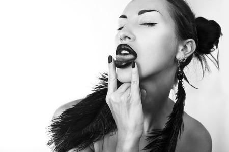 Beautiful stylish woman stick her tongue out, black-and-white photo (Cheeky youth) Stock Photo