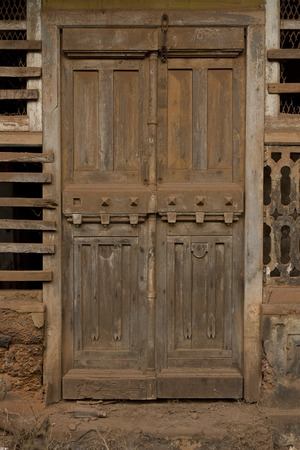 The Old wooden Door with Cracked Paint Background Stock Photo