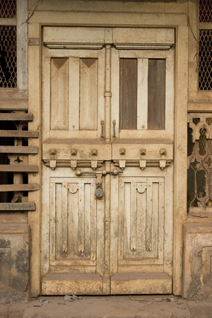 fanlight: The Old dirty white Door with Cracked Paint Background