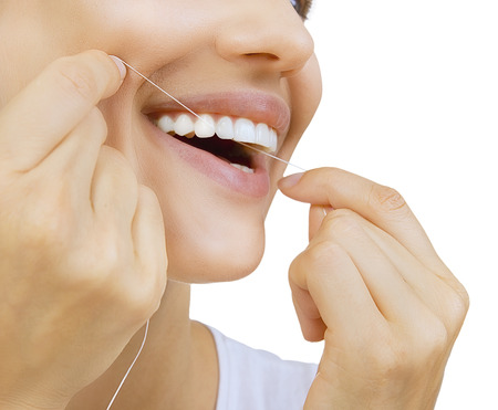 floss: Woman and teeth floss - Young caucasian woman flossing her teeth (close up woman smile)