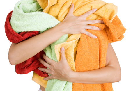 Woman holding a lot of colorful laundry in her hands, a lot of housework (Isolated on white background)