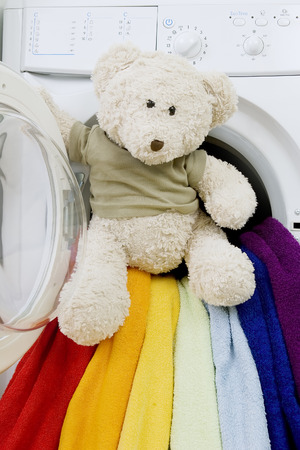 Delicate washing soft toys: Washing machine, toy and colorful things to wash Stock Photo