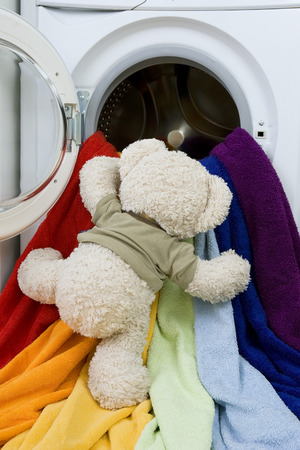 lave: Delicate washing soft toys: Washing machine, toy and colorful things to wash Stock Photo