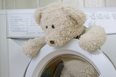 lave: fluffy childrens toy in the washing machine Stock Photo