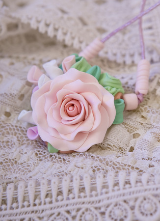 artificial flower: polymer clay jewelery: a floral rose necklace (jewelery made of polymer clay)