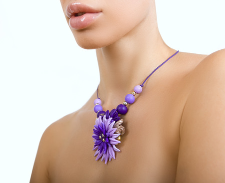 clay modeling: polymer clay jewelery: beautiful woman with a floral necklace around her neck, vintage accessories