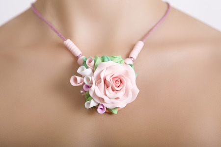 artificial flowers: Romantic style: polymer clay jewelery: a floral rose necklace (jewelery made of polymer clay), vintage accessories Stock Photo