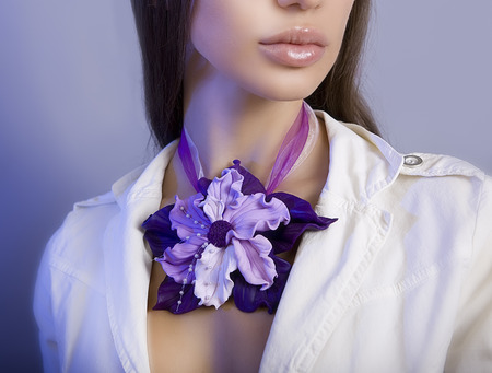 artificial flowers: Romantic style: polymer clay jewelery: beautiful woman with a floral necklace around her neck, vintage accessories