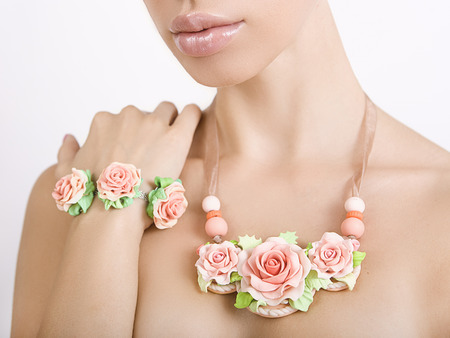 polymer clay jewelery: beautiful woman with a floral necklace around her neck and bracelet, vintage accessories photo