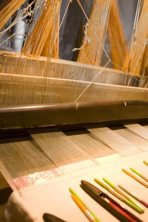 craftsmanship: traditional sari cloth, hand loom on old fabric factory